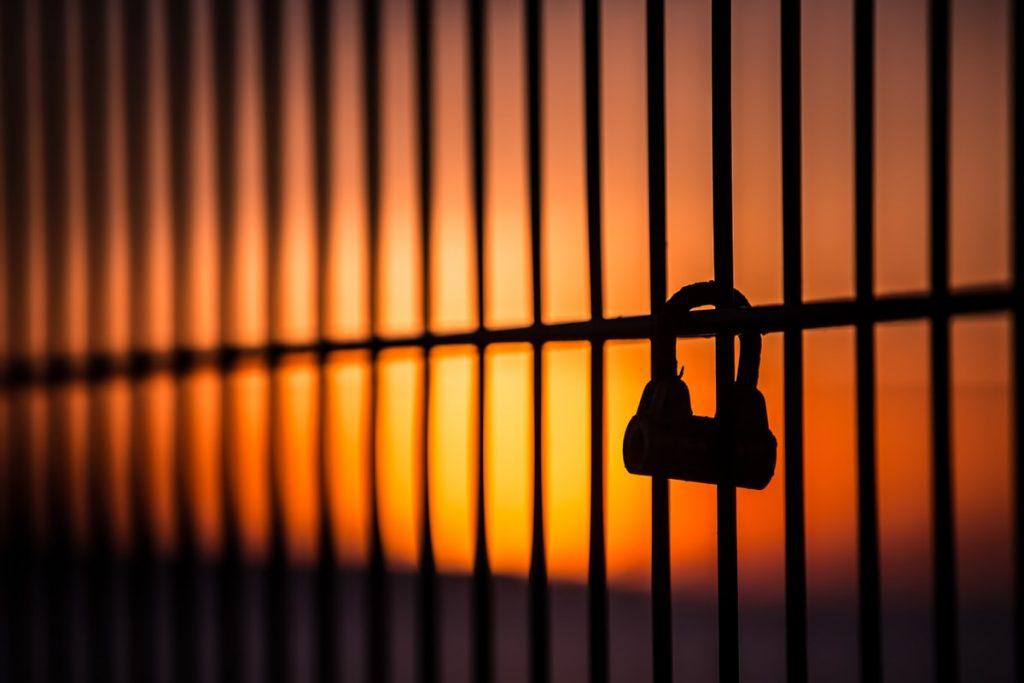 silhouette of padlock on window